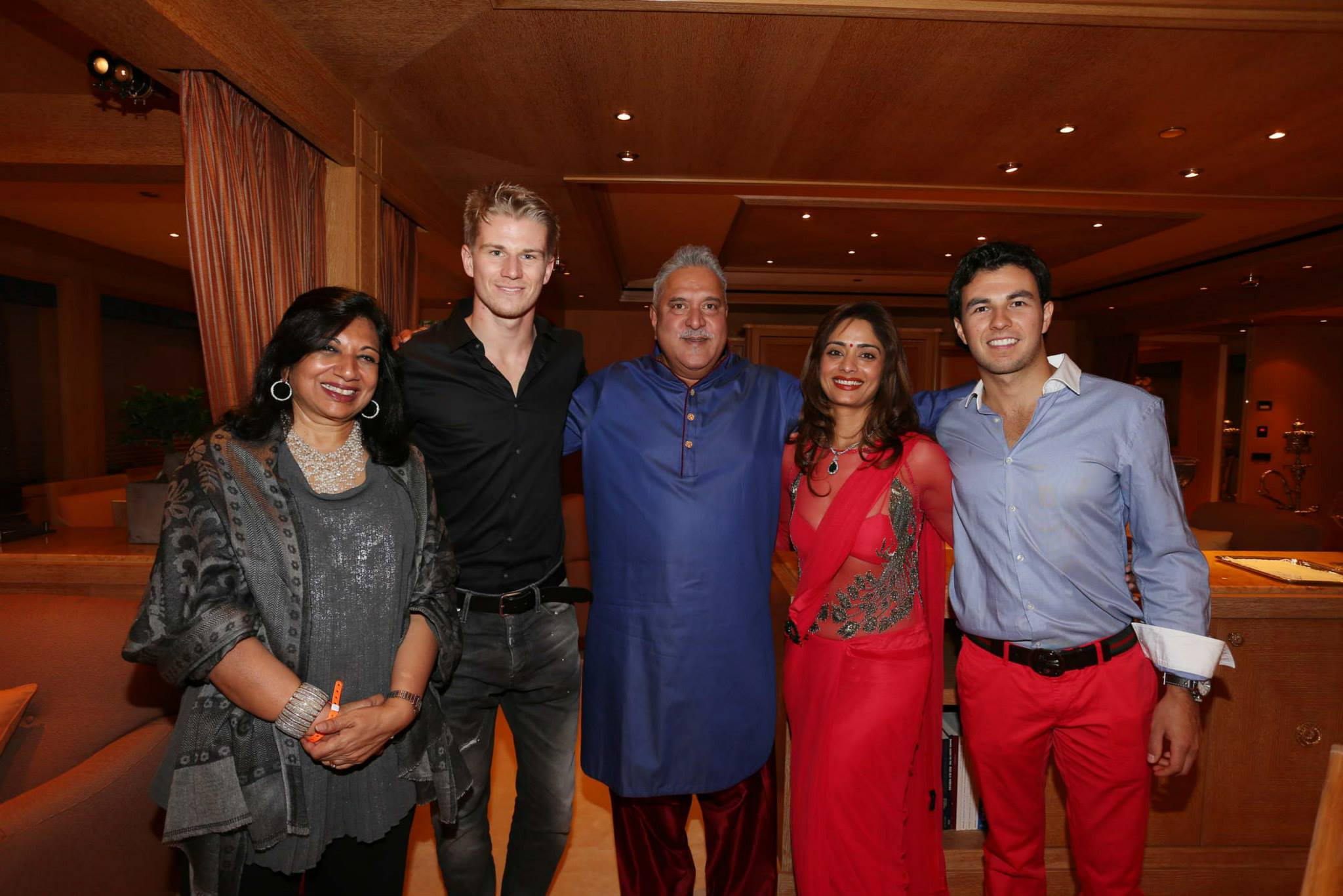 (L to R) Nico Hulkenberg (GER) Sahara Force India F1 with Dr. Vijay Mallya (IND) Sahara Force India F1 Team Owner and Sergio Perez (MEX) Sahara Forc